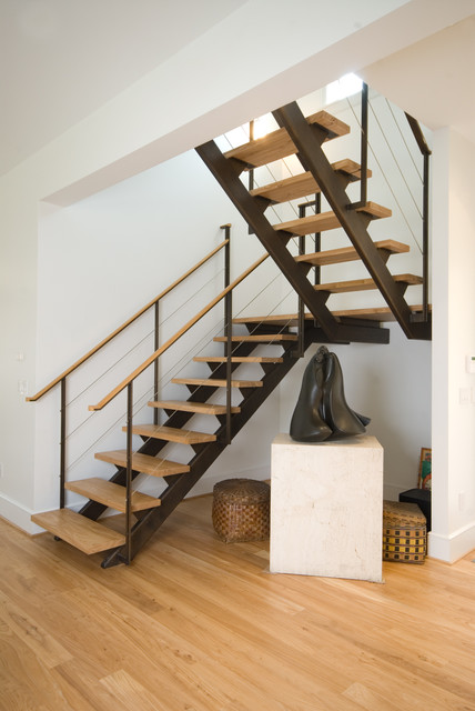 Staircase with a metal lava constructions for Stair and railing solution